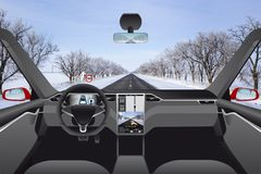 Self driving car without driver on a winter road. Indoor view Stock Image