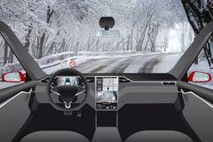 Self driving car without driver on a winter road Royalty Free Stock Image
