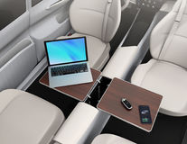 Self driving car interior. Smart car key, smartphone, laptop on the table Royalty Free Stock Photography