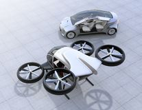 Self-driving car and passenger drone parking on the ground. 3D rendering image Stock Photos