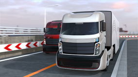 Self driving hybrid trucks on the highway stock footage
