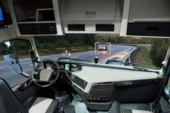 Self driving truck with head up display on a road. Inside view Royalty Free Stock Image