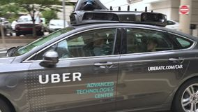 Self-driving uber car on streets of Pittsburgh. Pittsburgh - circa September, 2016 - a self-driving Uber car drives on the streets of Pittsburgh stock video footage
