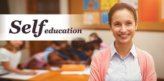 Composite image of self education word. Self education word against portrait of teacher smiling in classroom Stock Image