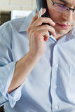 Self-employed man working at home. Talking on phone stock images