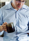 Self-employed man working at home. Drinking coffee Stock Photos