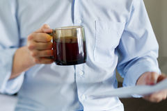 Self-employed man working at home. Drinking coffee stock image