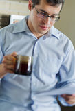 Self-employed man working at home. Drinking coffee Stock Photography