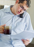 Self-employed man working at home. Using notebook. Relaxing Royalty Free Stock Photos