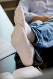 Self-employed man working at home. Resting - feet on the table Stock Image
