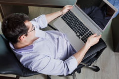 Self-employed man working at home. Using notebook. Relaxing Stock Images