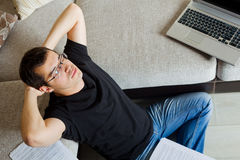 Self-employed man working at home. Using notebook. Relaxing Royalty Free Stock Images