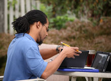 Self Employed Professional. A self employed professional man works from his deck at home on a sunny day Royalty Free Stock Image
