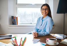 Self employed woman wearing glasses at desk Royalty Free Stock Images