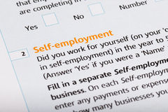 Self Employed. Word on a tax form royalty free stock image