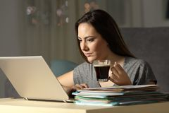 Self employed working late hours holding coffee mug. In the night at home stock photo