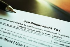 Self Employment Tax Form With Lomo Effect Close Up With Pen High Quality