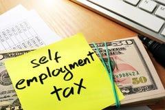 Self employment tax. Self employment tax written on a memo stick Stock Photography