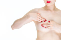Self exam against breast cancer, young female exam breast for si Stock Image