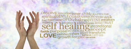 Self Healing Word Cloud. Female cupped hands reaching upwards on a subtle pastel multicolored bokeh background with a gold SELF HEALING word cloud to the right stock photos