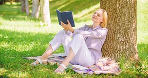 Self improvement and education concept. Business lady find minute to read book improve her knowledge. Female self stock photo