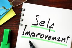 Self improvement. Self improvement sign written in a notepad Stock Images