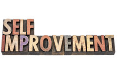 Self improvement words in wood type. Self improvement words  - isolated text in vintage letterpress  wood type printing blocks Royalty Free Stock Photos