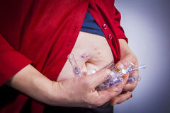 Self Injecting medical therapy Royalty Free Stock Photography