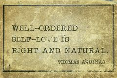 Self love Aquinas. Well-ordered self-love is right and natural - quote of ancient Italian priest, theologian and philosopher Thomas Aquinas printed on grunge Royalty Free Stock Photo
