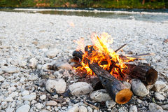 Self-made campfire by the mountain river Royalty Free Stock Images
