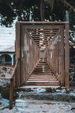 A self-made old wooden door on the street stock photo