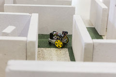 Self-made robot in a maze Royalty Free Stock Image