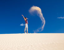 Self-made sand genie. Transitory flying sand sculpture in the air Stock Photo