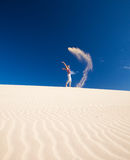 Self-made sand genie. Transitory flying sand sculpture in the air Stock Photography