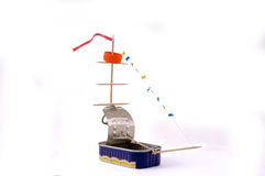 Self-made toy ship from a can. Self-made toy ship from a can, cap and picks isolated on white Royalty Free Stock Images