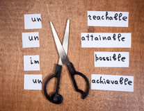 Self motivation concept. Negative words cut with scissors. Royalty Free Stock Images