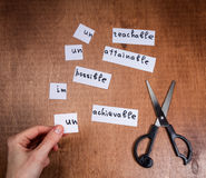 Self motivation concept. Negative words cut with scissors. Stock Images
