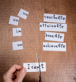 Self motivation concept. Negative words cut with scissors. Royalty Free Stock Photo
