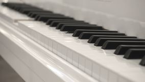 Self-Playing White Piano Without Pianist. Playing Piano Itself. Close Up Side Angle View.  stock footage