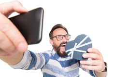 Selfie portrait of attractive, crazy bearded man in jeans shirt shooting selfie with heart over white background. Self portrait of attractive, crazy bearded man royalty free stock photos
