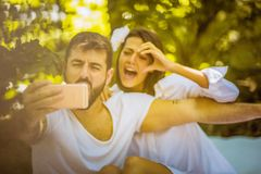 Self portrait of beautiful young couple. Close up. royalty free stock photography