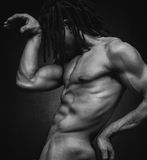 Self Portrait. Black and white nude portrait of man with dread locks Royalty Free Stock Photos