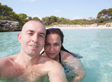 Self-portrait of a couple in the beach Royalty Free Stock Images