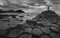 Self portrait in giants Causeway - Black and white Royalty Free Stock Photo