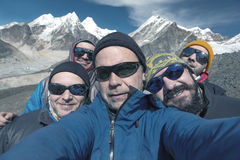 Self Portrait of Group of smiling Mountain Climbers. Self Portrait of Group of smiling and excited Mountain Climbers in windproof Jacket Sunglasses and Caps with Stock Images