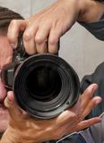 Self-portrait of the hands in the mirror holding a SLR camera royalty free stock images