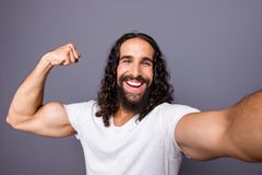 Self-portrait of his he nice cool attractive cheerful cheery glad wavy-haired guy showing muscle demonstrate proud royalty free stock photo