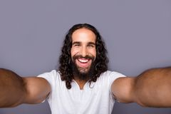 Self-portrait of his he nice cool well-groomed attractive cheerful cheery glad ecstatic optimistic wavy-haired guy. Lifestyle isolated over gray violet purple royalty free stock photo