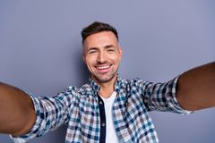 Self-portrait of his he nice-looking attractive well-groomed cheerful cheery bearded guy wearing checked shirt isolated royalty free stock photography