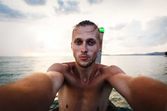 Self-portrait of a man against the sea. Self-portrait of a young handsome man on the sea background Stock Image